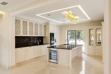 Portorose quartzite kitchen top and island, profiled Crema Marfil for skirting.